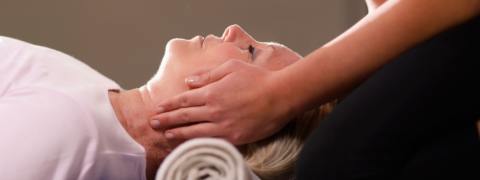 Woman being treated with Reiki